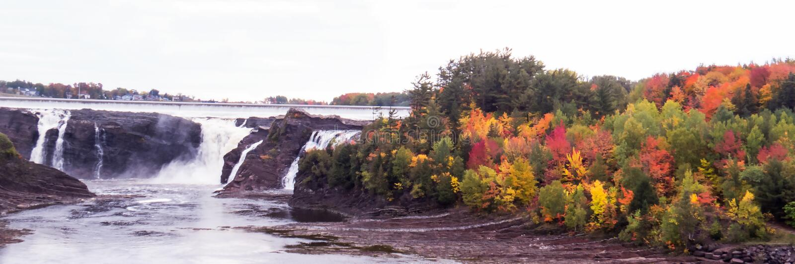 Panoramic: Waterfalls with a lot of distant colorful trees stock images