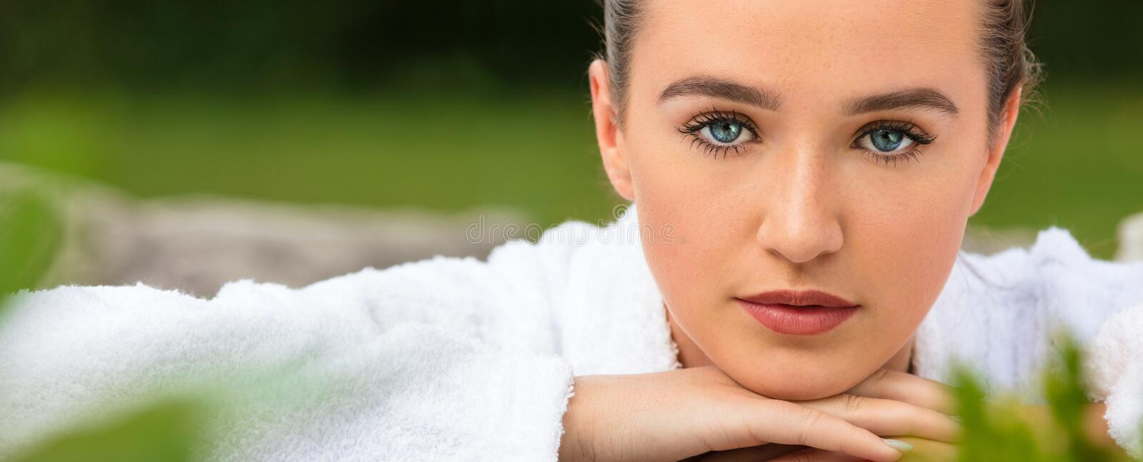 Beautiful Young Woman Relaxing in Robe at Health Spa stock photography