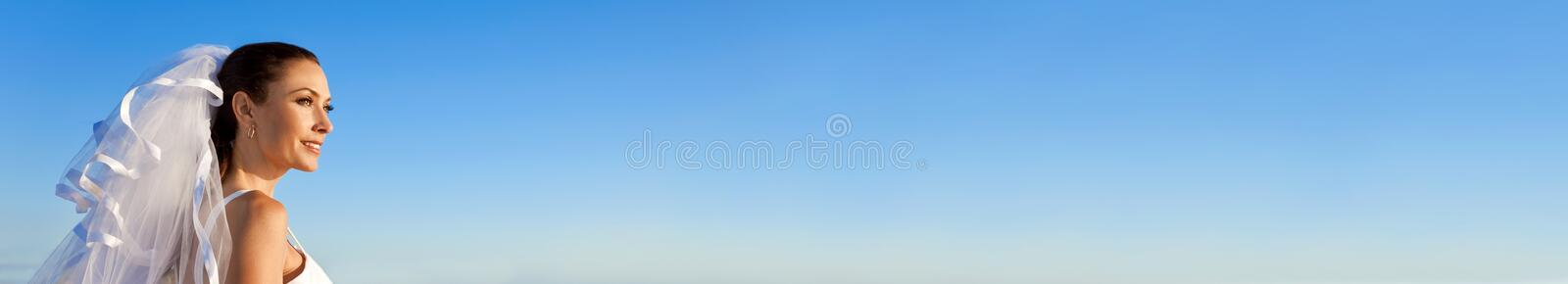 Panoramic Web Banner Bride Wearing Wedding Dress With Blue Sky stock image