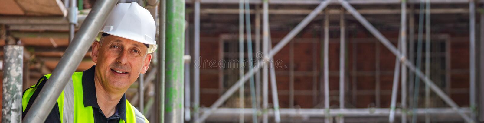 Construction Foreman Builder on Building Site Panorama Web Banner stock photos