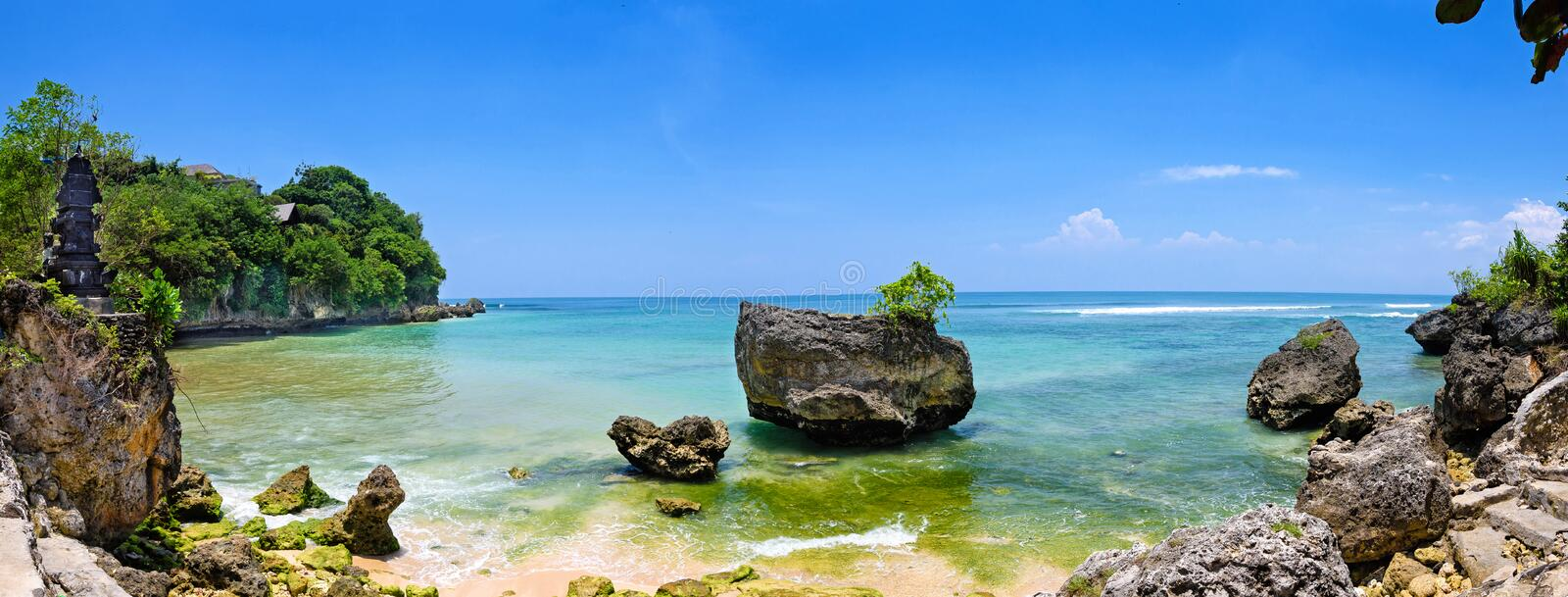 A panoramic wide-screen view of padang padang beach in bali royalty free stock image