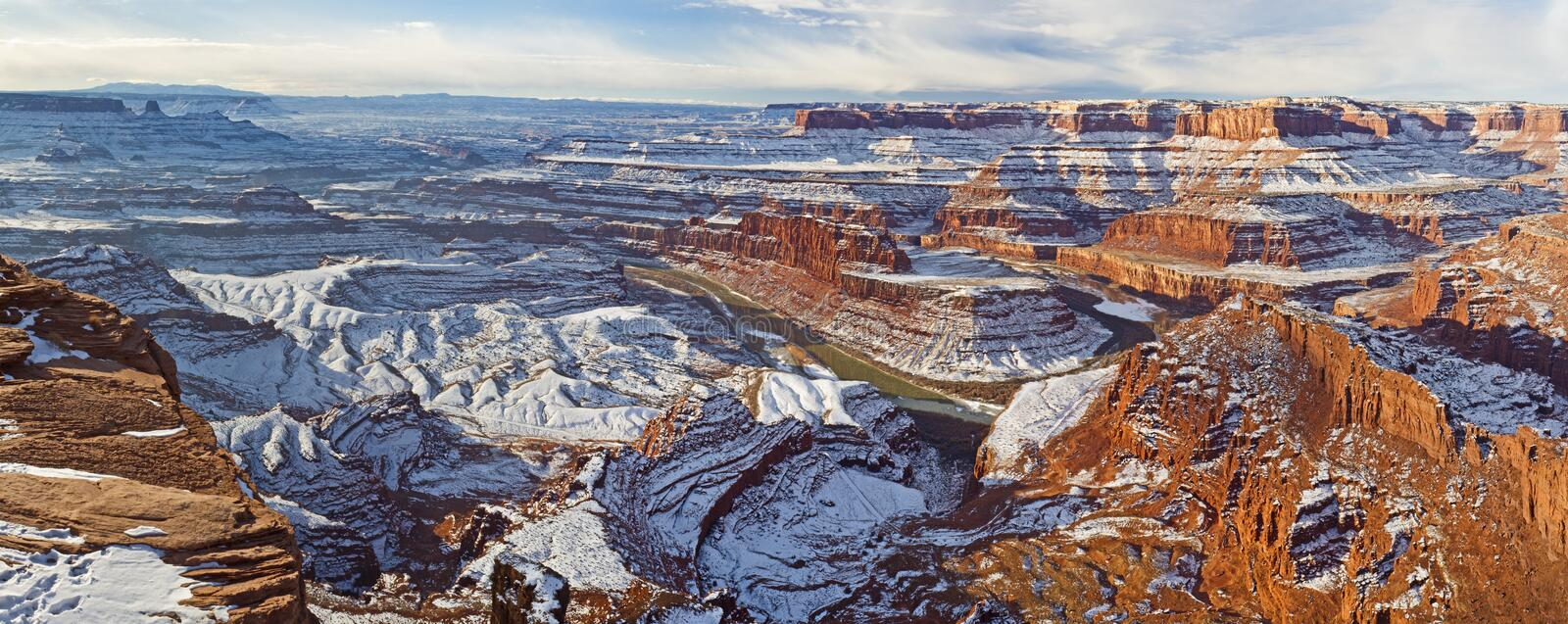 Dead Horse Point Winter Panorama. Panoramic wintry view of a gooseneck bend in the Colorado River and Canyonlands National Park from Dead Horse Point Overlook in stock photo