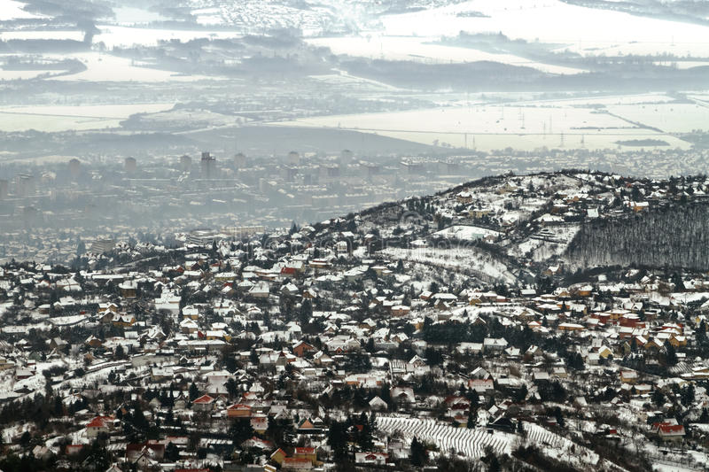 Panoramicl view of a town in winter with smog royalty free stock images