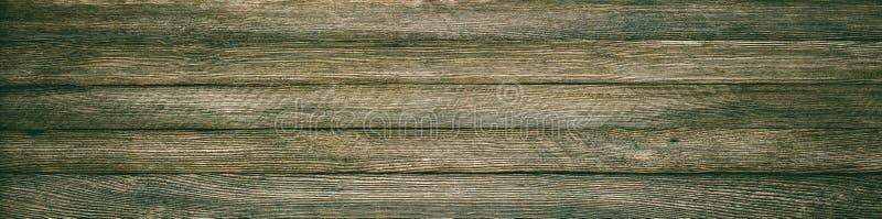 Panoramische die retro grungeachtergrond van houten planken met vignet wordt gemaakt stock foto