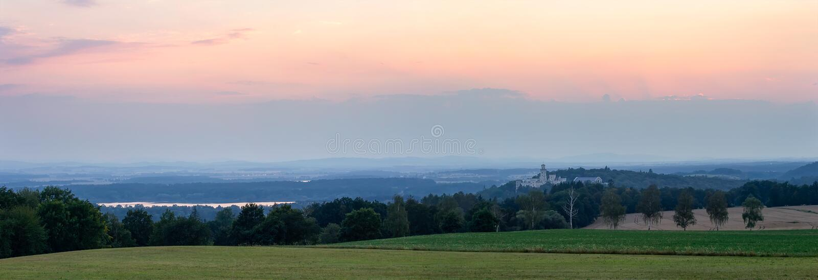Panoramtic view to renaissance chateau Hluboka nad Vltavou in sunset stock image