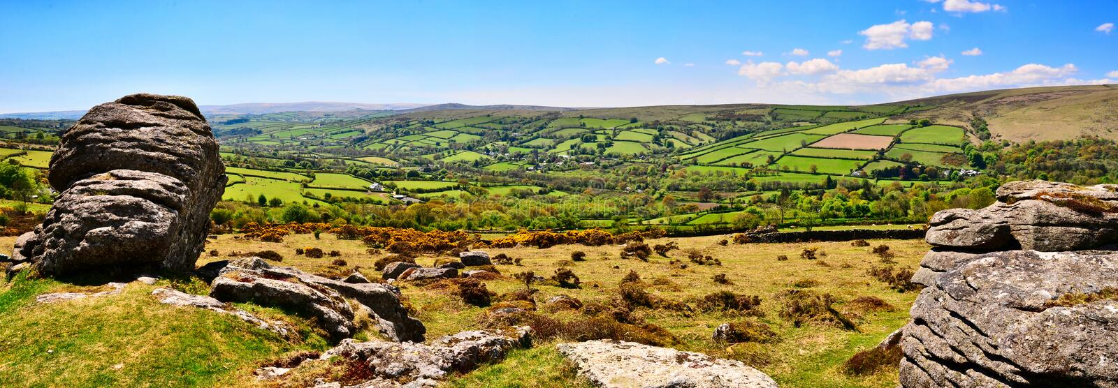 Panormic View Of Dartmoor With Widecombe-in-the-Moor In The Distance. Stock Photos