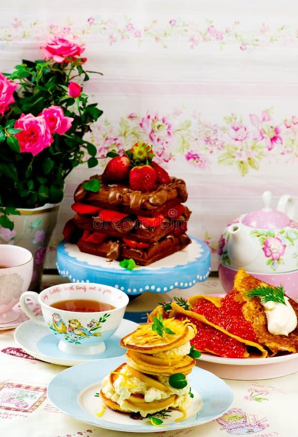 Panquecas, blinis, e waffles foto de stock