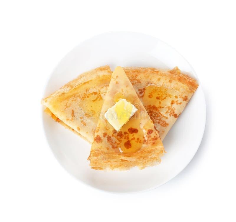 Panquecas dobradas finas saborosos com manteiga e mel imagens de stock royalty free