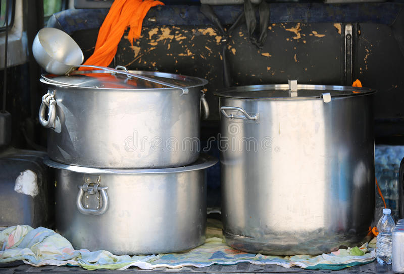 Pans for transporting food in a van of non-governmental organiza. Three large pots for transporting food in a van of non-governmental organizations in a refugee royalty free stock photography