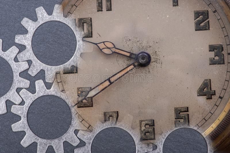 Panta rhei concept: antique, old, vintage pocket watch and hour metal gears on natural stone. Background stock photos