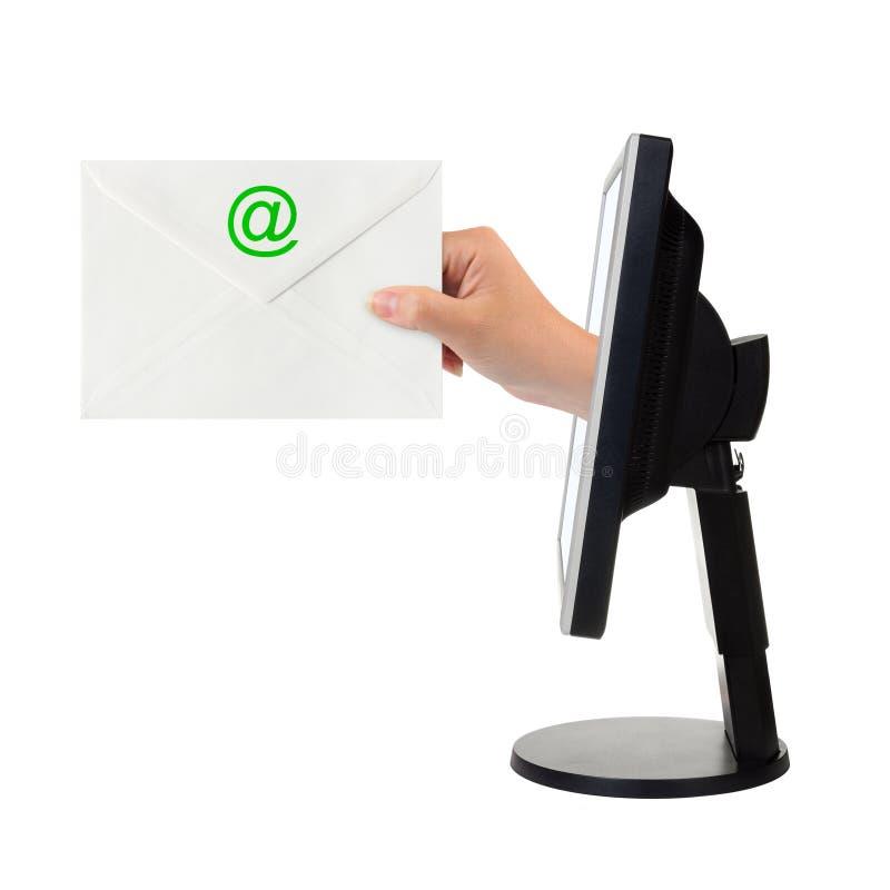 Pantalla de ordenador y mano con la carta fotos de archivo libres de regalías