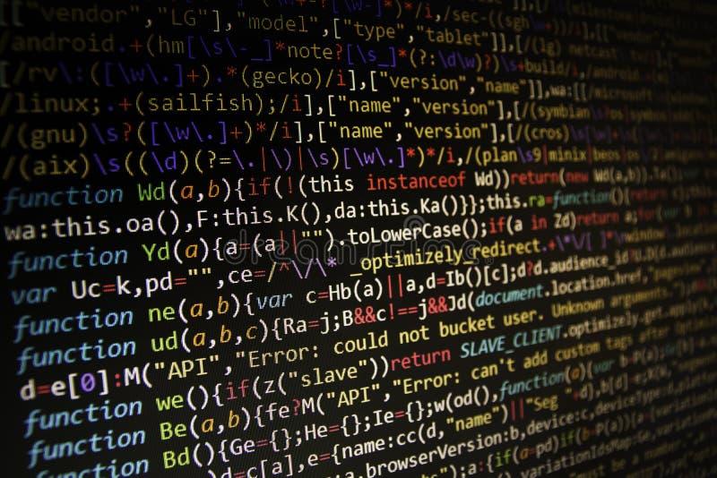 Pantalla programada del código del desarrollador de software Ordenador fotografía de archivo