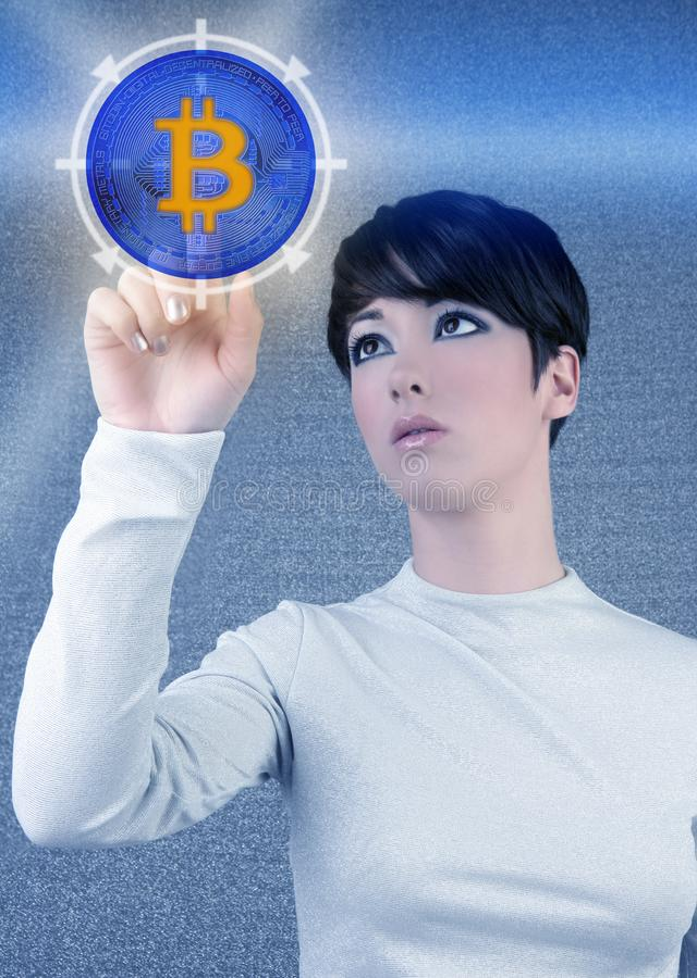 Pantalla táctil futurista de la mujer de Bitcoin BTC fotografía de archivo