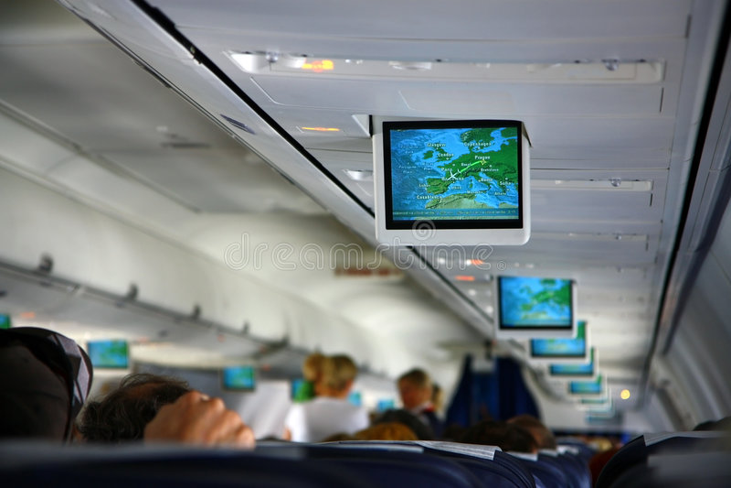 Pantallas dentro de los aviones fotografía de archivo