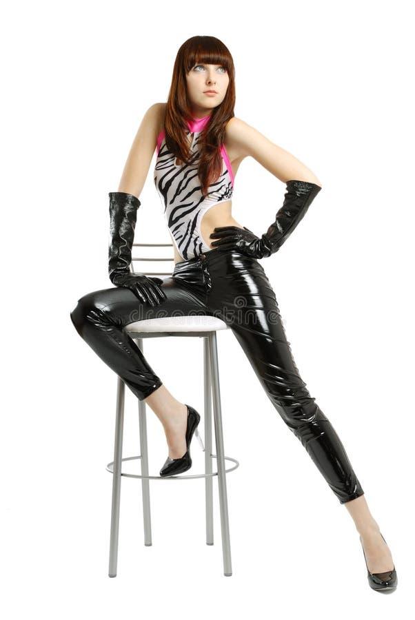 pantalon de pattes en cuir de fille long très image stock
