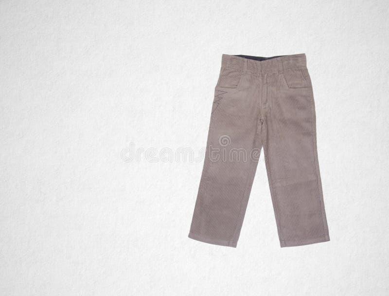 pantalon ou pantalon d'enfant sur un fond image stock