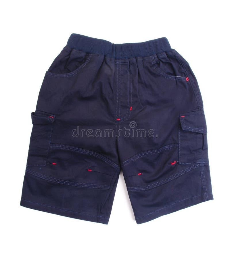 Pantalon, pantalon d'enfant sur le fond. photographie stock libre de droits