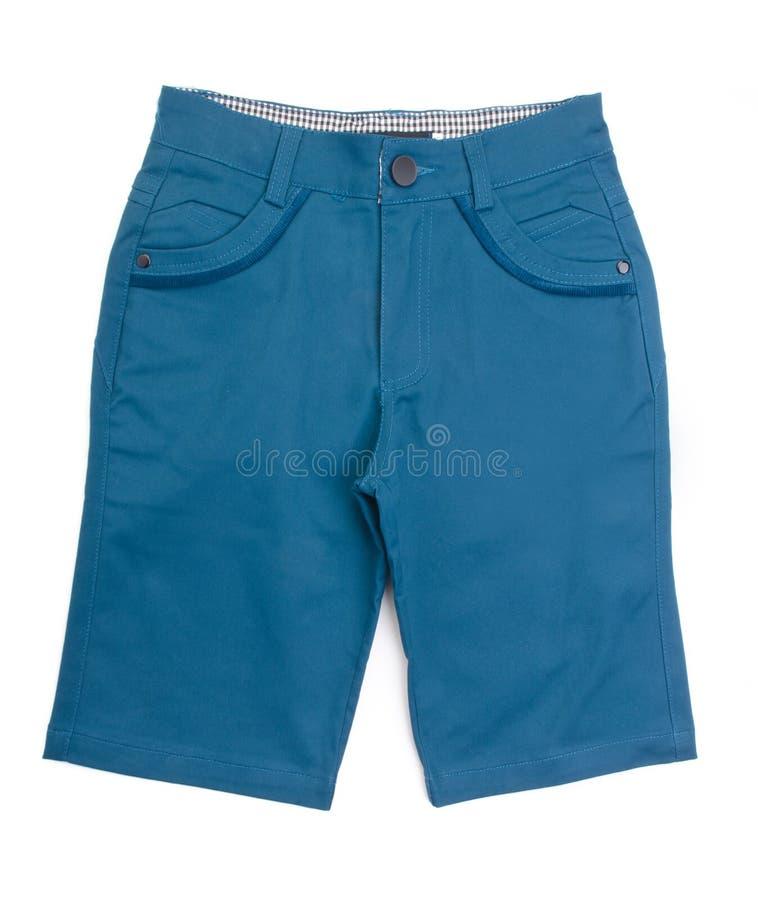 Pantalon, pantalon d'enfant sur le fond. photos stock