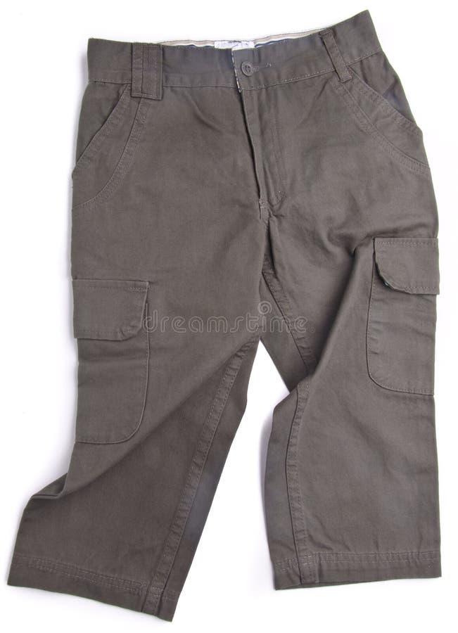 Pantalon, pantalon d'enfant sur le fond image libre de droits