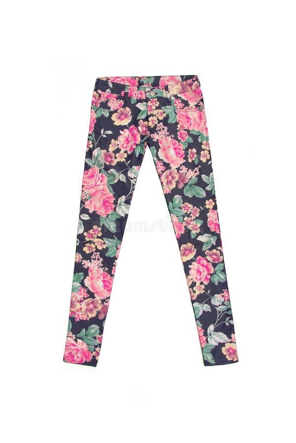 Pantalones coloridos de los vaqueros con el estampado de flores fotografía de archivo libre de regalías