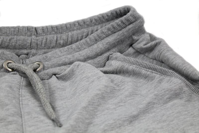 Pantalones cortos grises de los hombres imágenes de archivo libres de regalías