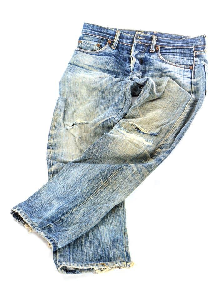Pantalones usados viejos de los vaqueros aislados fotografía de archivo