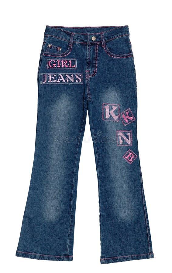Pantalones vaqueros azules de la muchacha de los niños aislados imagen de archivo