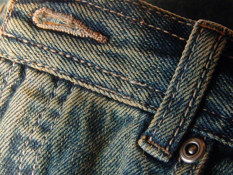 Pantalones vaqueros - botón y bucle delanteros imagenes de archivo
