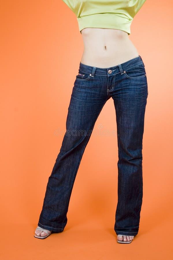 Pantalones vaqueros de la muchacha imagen de archivo libre de regalías