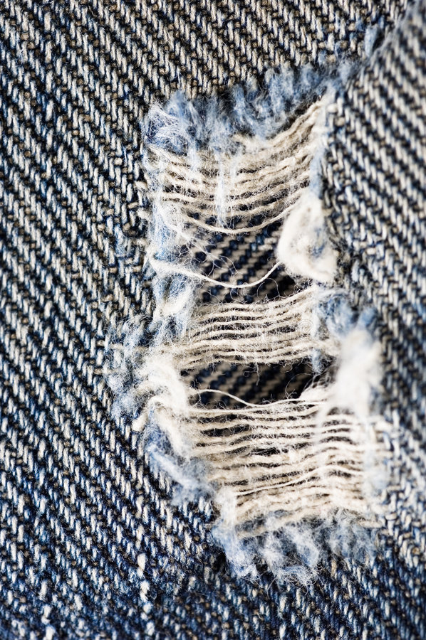 Pantalones vaqueros rasgados foto de archivo