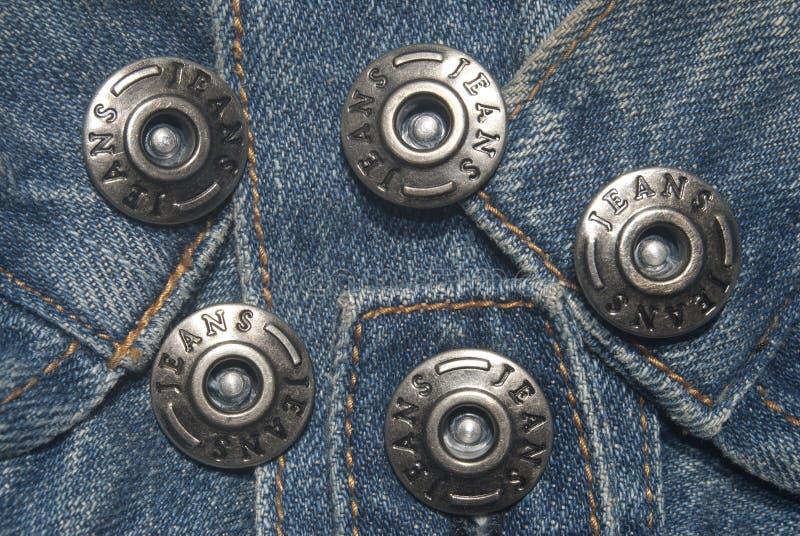 Pantalones vaqueros y botones imagen de archivo