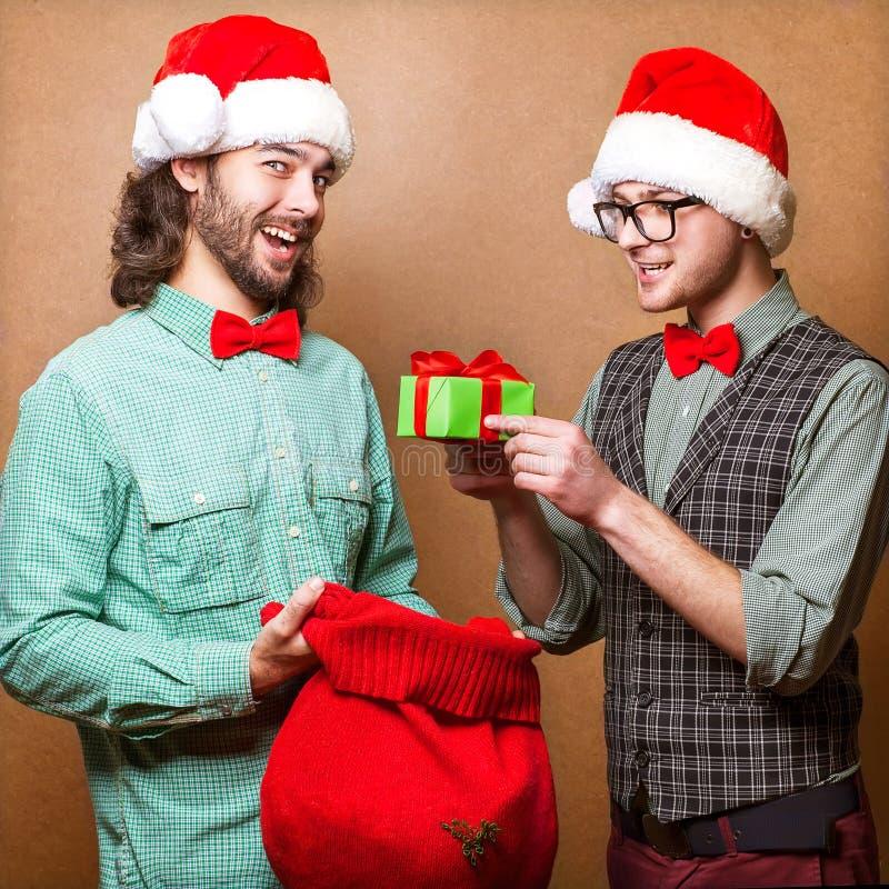 Pantaloni a vita bassa due in Santa Claus fotografie stock