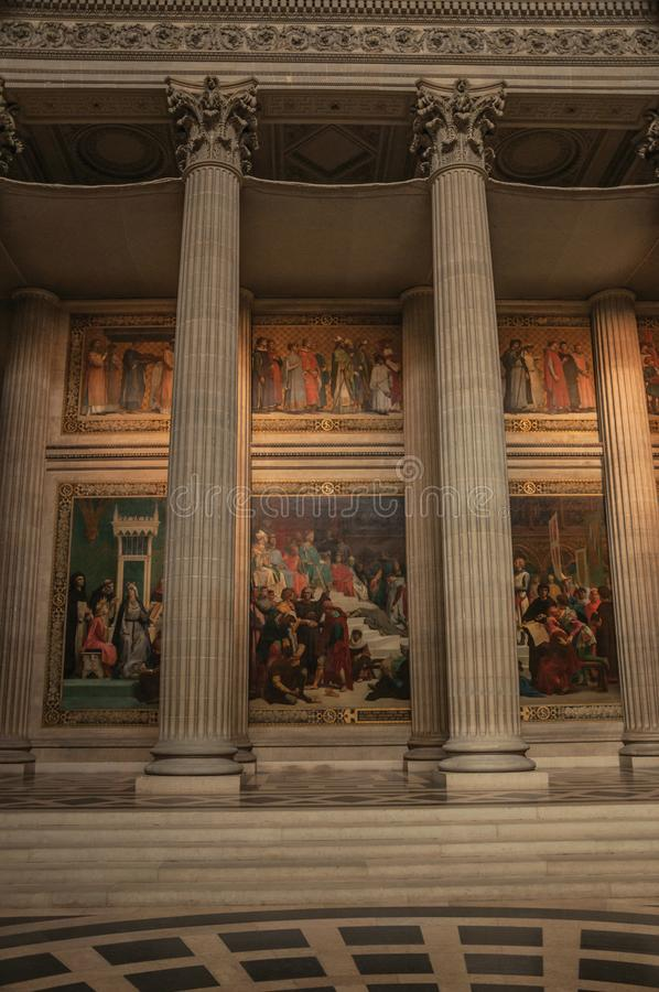 Pantheon inside view with high ceiling, columns, statues and paintings richly decorated in Paris. royalty free stock photography