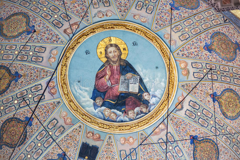 Pantocrator in t Greek Orthodox Church in Istanbul. ISTANBUL, TURKEY - APRIL 12, 2015: Dome paintings depicting the Pantocrator in the Hagia Triada Greek stock image