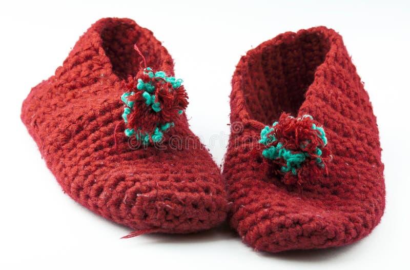 Pantofole tricottate rosso fotografia stock libera da diritti