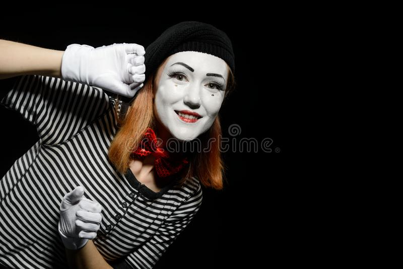 Pantomime actress leaning on wall stock images
