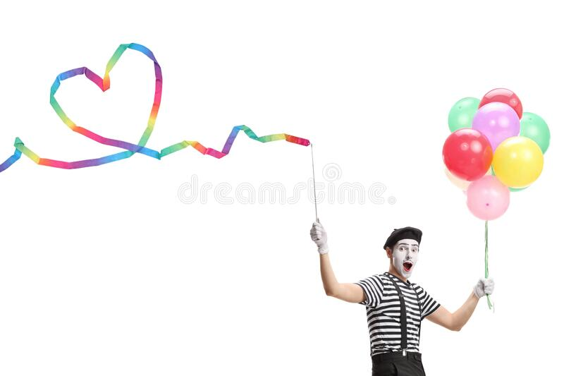 Pantomime man holding a ribbon with a heart shape and a bunch of colorful balloons royalty free stock photos