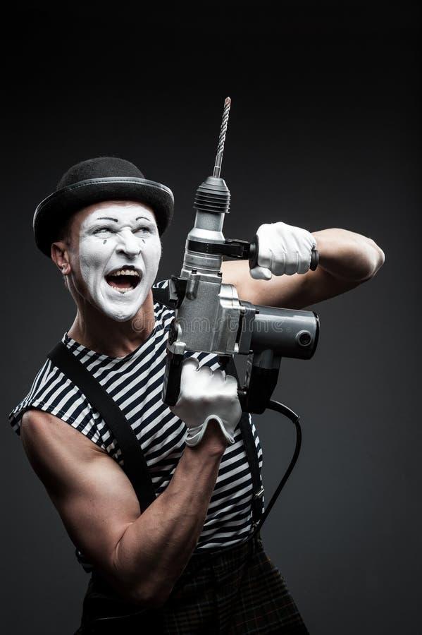 Pantomime mit Bohrhammer stockfoto