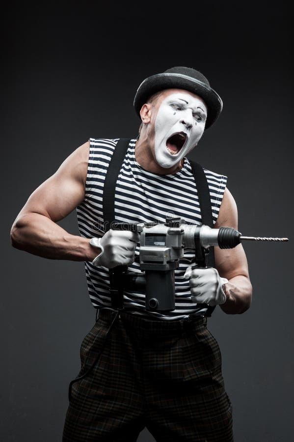 Pantomime mit Bohrhammer stockbilder