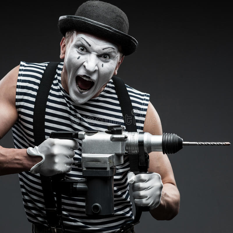 Pantomime mit Bohrhammer stockbild
