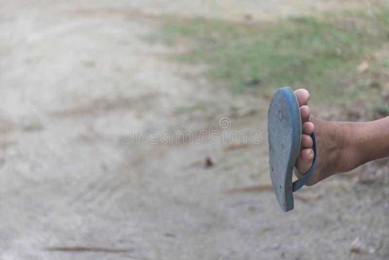 pantoufle de pied d'homme images stock