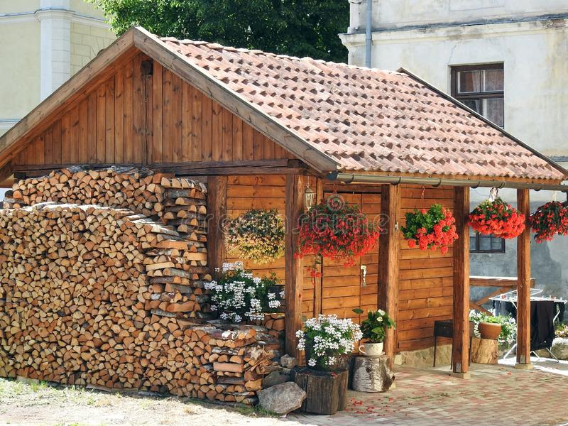 Pantry building, firewood and flowers, Latvia stock image