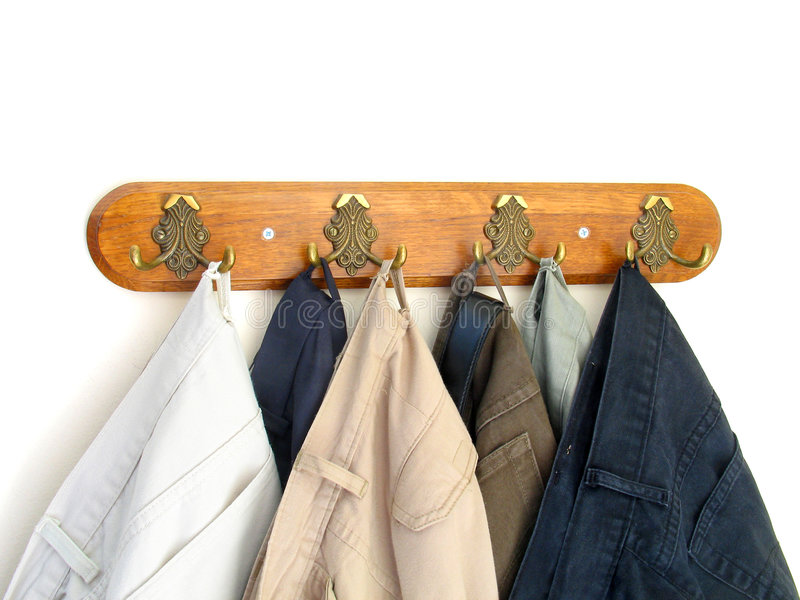 Pants hung on the hooks. Some pants hung neatly on a row of hooks stock photography