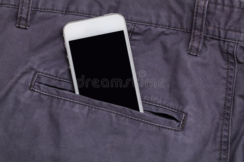 Pants pocket and smartphone stock images