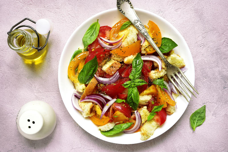 Panzanella - traditional italian tomato salad with bread and onion.Top view. stock photos