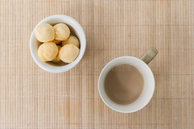Pao de Queijo Bread Cheese and cup of coffee with milk on wood stock photos