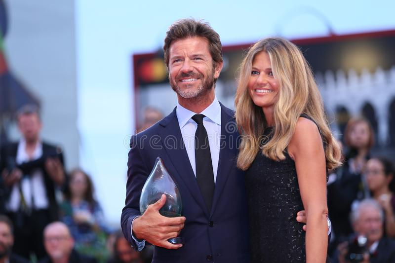 Paolo Conticini and Giada Parra. Walk the red carpet ahead of the `One Nation One King Un Peuple Et Son Roi` screening during the 75th Venice Film Festival at stock images