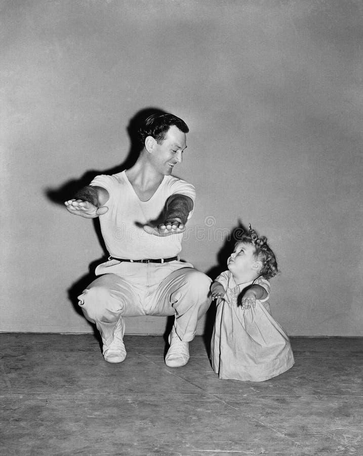 Papá de imitación del bebé fotos de archivo