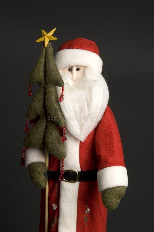 Papá Noel con el árbol imagen de archivo
