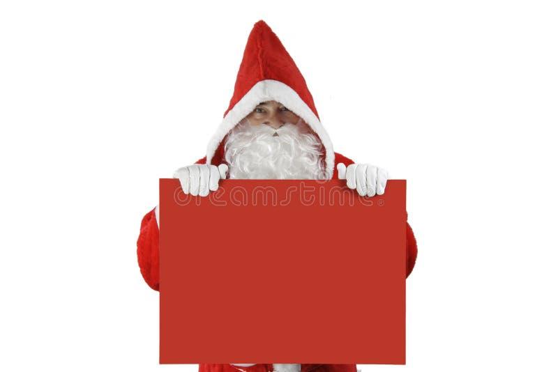 Papá Noel con la tarjeta roja imágenes de archivo libres de regalías